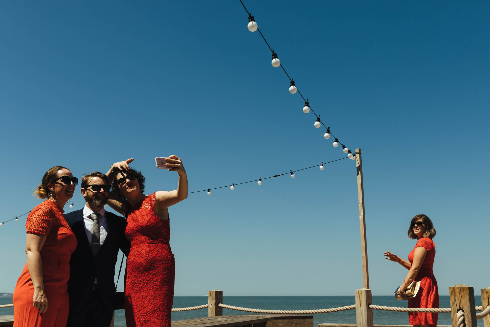 festoon lights at beach wedding