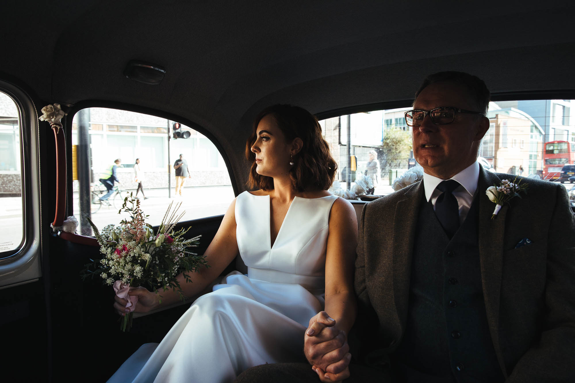 Bride and father in London wedding taxi