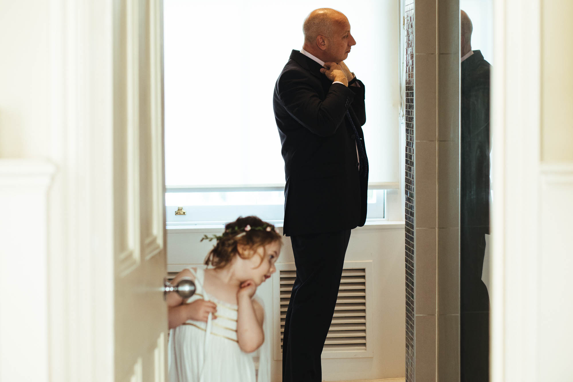 flower girl and groom getting ready